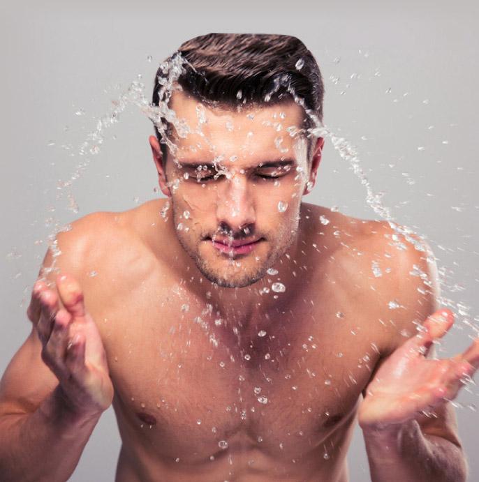 male model washing his face - dermatology image 01